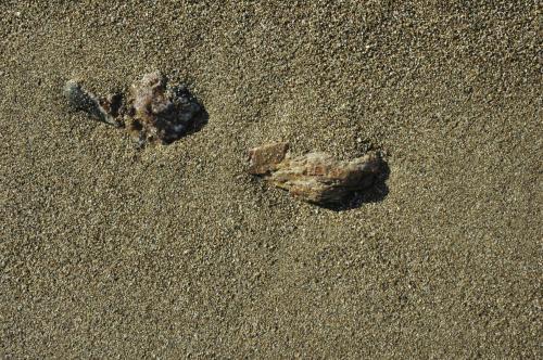 Sand und Steine am Strand